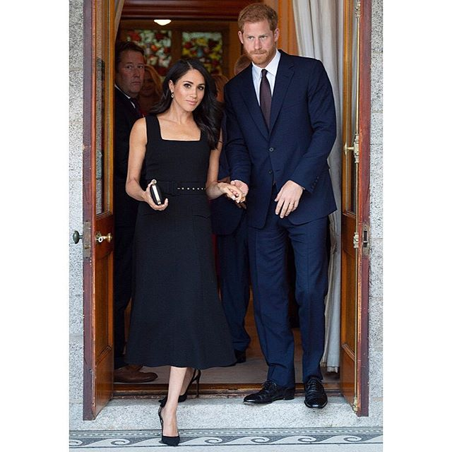 The Duke and Duchess of Sussex undertook their first overseas engagement as a married couple in Dublin. The trip included multiple events and outfits changes, including this black dress by @emiliawickstead that Meghan Markle wore for a party at the British Ambassador s home. #wwdfashion #royals