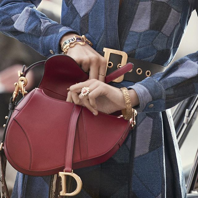 ''The 'Saddle' bag is one of those emblematic pieces that always manages to remain contemporary. It's also one of the codes that symbolizes Dior's recent history,'' states #MariaGraziaChiuri. Referencing the world of equestrianism and decorated with a stirrup-like gilt 'D', the iconic 'Saddle' bag is one of the stars of the new Autumn-Winter 2018-2019 campaign. Whether carried by hand or worn across the body with its new fringed strap, it is the cult accessory of the season.  #DiorSaddle   @Pamela_Hanson