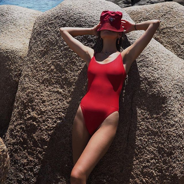Making waves: @erika_boldrin wears the red hot Core Neo suit from #CALVINKLEIN. Get yours now at the link in bio [EU].                                                       Share yours. #MYCALVINS
