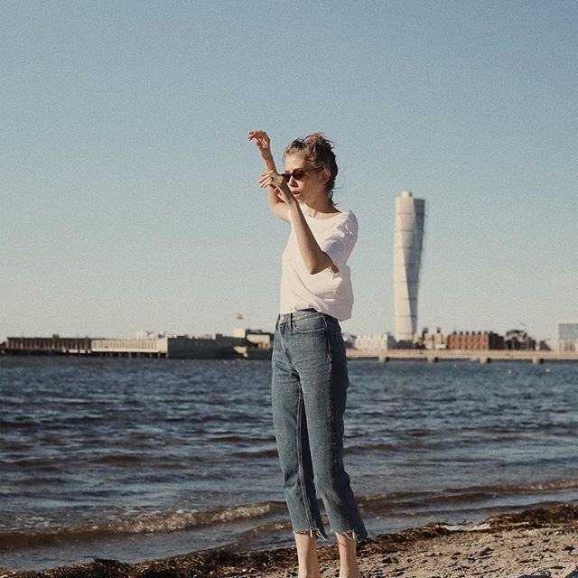 On the waterfront: @jennymustard wears classic #denim from #CALVINKLEINJEANS.           Share yours. #MYCALVINS