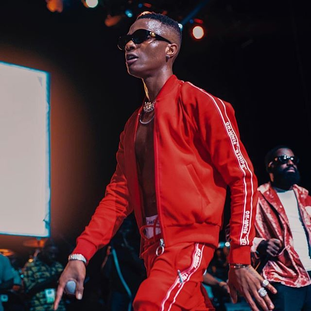@wizkidayo in red fw18 Off-White  track suit photograph c/o @ghfinext