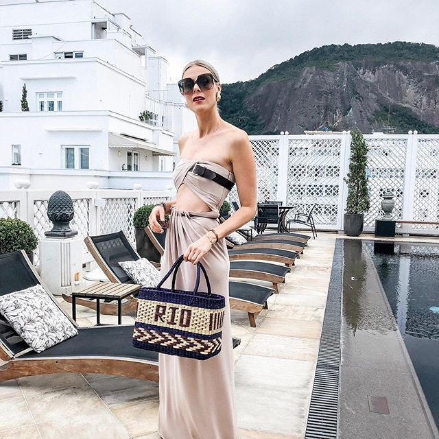 Ignoring the rain and going for a dip! It's just water, right?     Also, can we talk about this amazing cut-out @albertaferretti dress?? So obsessed!  #riodejaneiro #pooltime #summervacay @belmondcopacabanapalace #theartofbelmond