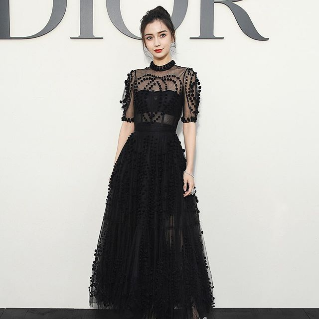 The actress and model Angelababy was the epitome of elegance and charm in an embellished breeze of black tulle to attend the Spring-Summer 2019 show from #MariaGraziaChiuri's.  #StarsinDior