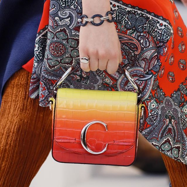 From vibrant gradient sunset hues to elegant croc embossed leather, the #chloeSS19 runway bags express the range of @NRamsayLevi s  Hippie Modernism  vision. Shown here, the Chloé C bag makes its debut in various shapes and patchwork treatments, the Tess is revisited in new summery natural shades, and the Marcie returns in celebration of its 10th anniversary. Discover more on chloe.com #chloeGIRLS