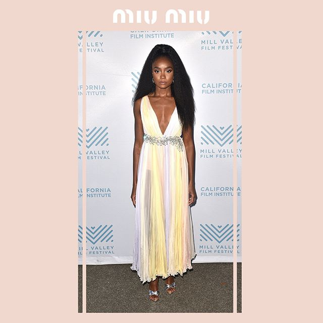 @KikiLayne in a #MiuMiu multicolored sheer georgette gown with crystal embellishment,  attending the première of  If Beale Street Could Talk  during the Mill Valley Film Festival on October 14, 2018 in San Rafael, California.