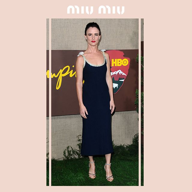 Actress @JulietteLewis in a #MiuMiu stretch sablè dress with crystal trim and bows, attending the première of the HBO series  Camping  on October 10, 2018 in Hollywood, California.  #MiuMiuCelebrities