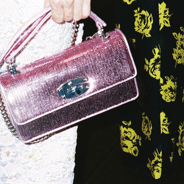 The new #MiuCleo bag in dazzling sequins starring in the latest #MiuMiuWomenstales film, The Wedding Singer's Daughter by @haifaa.almansour.  Photo by #KimiSelfridge