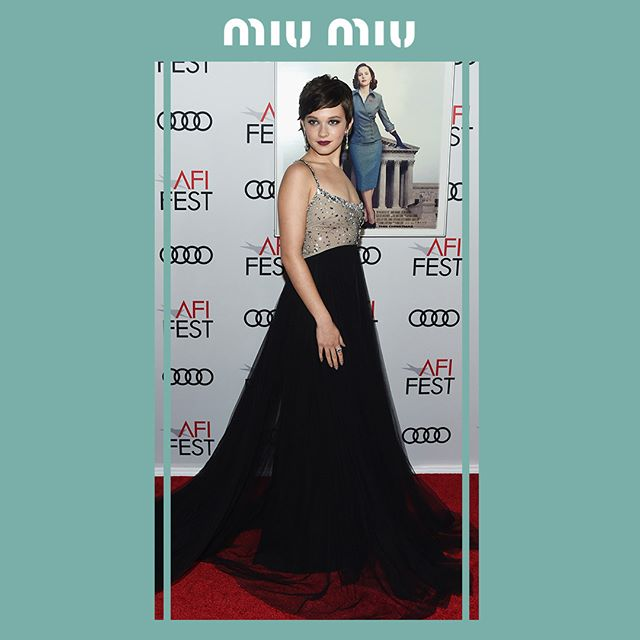 Cailee Spaeny in a #MiuMiu gown with sequins all-over embroideries bustier and black faille cady skirt while attending the première of  On The Basis Of Sex  during the AFI FEST on November 9th, 2018 in Hollywood, California.  #MiuMiuCelebrities