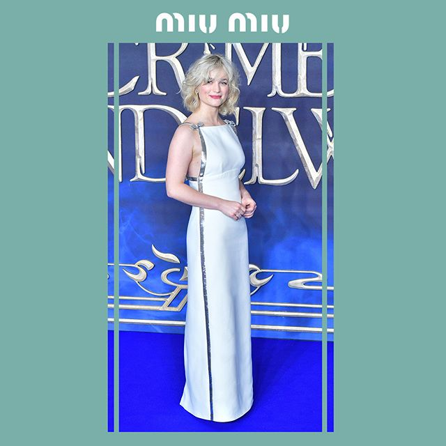 @AlisonSudol in a Miu Miu white georgette gown with sequins embroideries while attending the première of  'Fantastic Beasts: The Crimes Of Grindelwald  on November 13th, 2018 in London.  #MiuMiuCelebrities