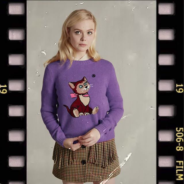 @ellefanning and the beloved Dinah, Alice s kitten from Disney s Alice in Wonderland. Discover the #MiuMiu Little Cats wool sweater capsule collection at miumiu.com.