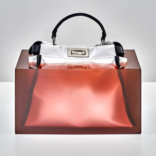 "Fendi marked the 10th anniversary of its Peekaboo bag by partnering with artists to reinterpret it for Design Miami. Sabine Marcelis, for one, froze the handbag within a resin block, allowing ""translucent colors"" to emphasize the shape of the bag. The designs will be on display at Design Miami, running Dec. 5 9.  #wwdnews  #fendi #fendipeekaboo"