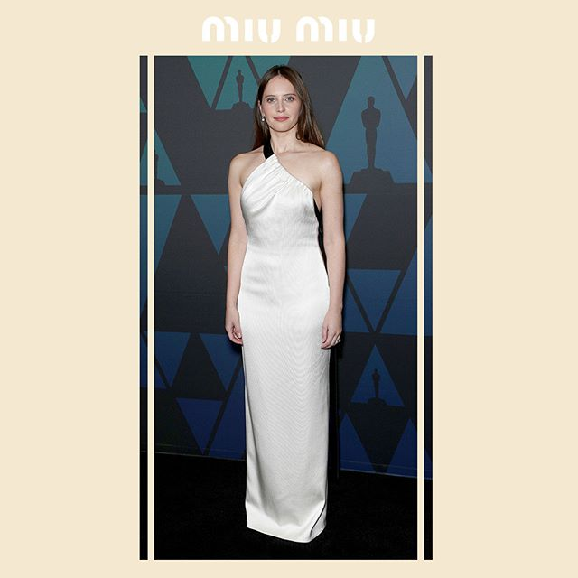 Felicity Jones in a #MiuMiu white satin gown while attending the  Academy Of Motion Picture Arts And Sciences 10th Annual Governors Awards  on November 18, 2018 in Hollywood. #MiuMiuCelebrities