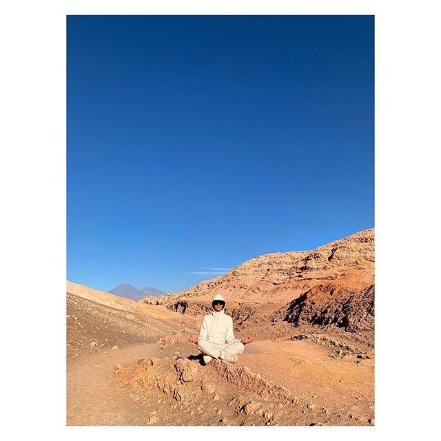I ve have tried to meditate for years - I knew it would be amazing but then, you know, life. .  Our retreat in the Atacama Desert was about self discovery and to me, an essential part of knowing yourself is learning how to be centered and, as @gwynethpaltrow talked about in our podcast, aligned    . I LOVED the teachings of @susan.piver because of their simplicity and  actionability  - since I came back, I kept my practice. And though I am still  terrible at meditating  (there is no such thing as that) I can already feel the incredible impact it s having on my life... . PS this is me in the Moon Valley, and these are the Andes behind in the back (can you believe this? The mythical Andes!!!) I am totally NOT meditating and I am posing for the photo and giggling. Also yes I look like some character from Star Wars. .  Do you meditate? What s your style? More photos of this amazing, amazing Moon Valley, in stories.  Oh and link to my podcast with @gwynethpaltrow in bio.  @atelierdore #atelierdoredoes