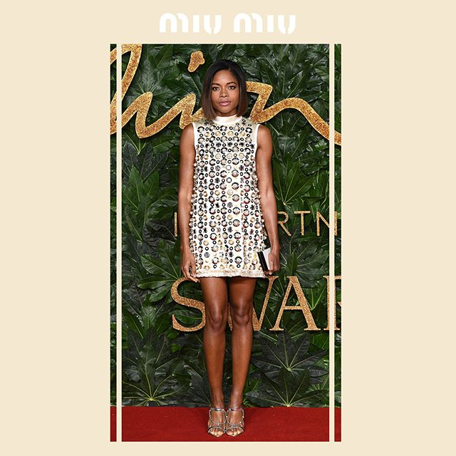 Naomie Harris in a #MiuMiuCroisiere19 dress with an all-over embellishment of pearls and metallic details, during the British Fashion Awards 2018 on December 10, 2018 in London. #MiuMiuCelebrities