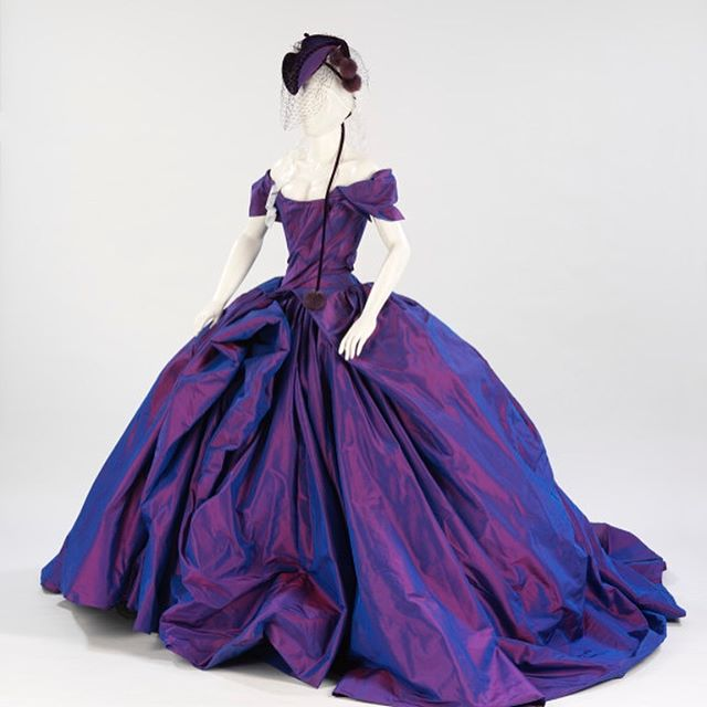 Perfection in purple. This gorgeous taffeta gown by @viviennewestwood was worn by burlesque superstar @ditavonteese for her 2005 wedding.  Did you know that white became the go to colour for wedding dresses after Queen Victoria's wedding to Prince Albert in 1840?  #Wedding #Dress #Purple #Ditavonteese #Weddingdress #celebrityweddingdress #weddingdressinspo #colours #westwood #viviennewestwood
