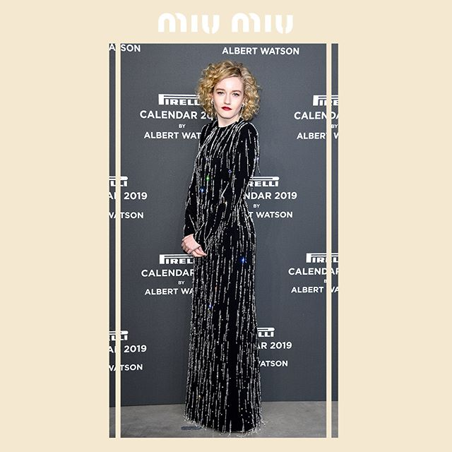 Julia Garner in a #MiuMiu black sablé dress with luminous all-over crystal embroidery while attending the 2019 Pirelli Calendar launch gala, on December 5, 2018 in Milan. #MiuMiuCelebrities