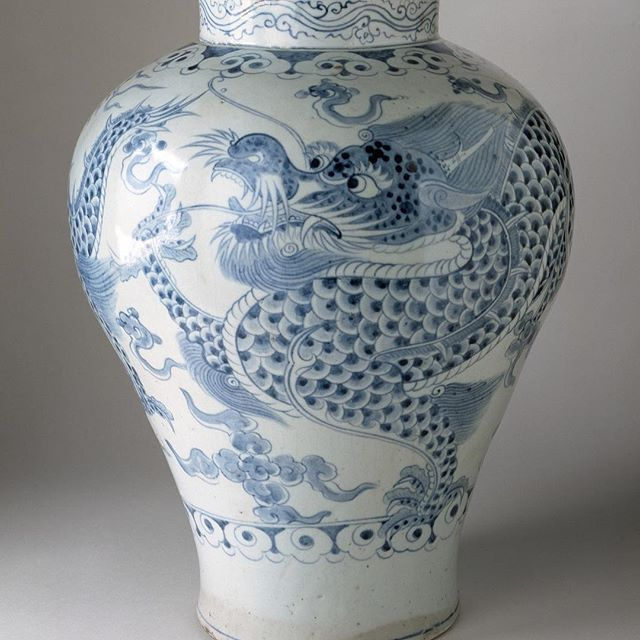 "This ""Jar with Dragon and Clouds"" from Korea, Joseon dynasty (1392-1910), 18th century, features a scaly dragon with big friendly eyes, sharp teeth, small horns, and a lively mane.   This jar was used by royal family. The brilliant blue color is made from fine cobalt oxide pigment.  See it in the Hammer building, level 2."