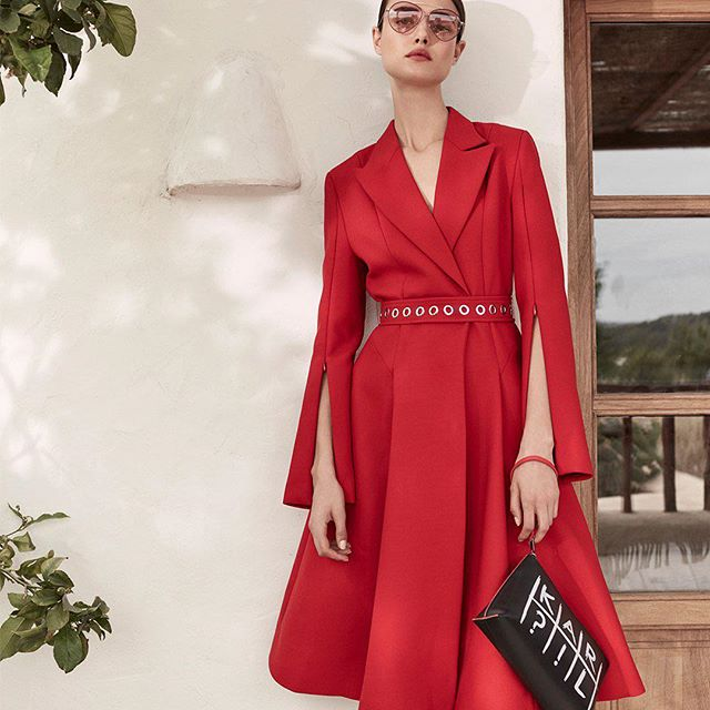 Embrace the glamour of a crimson capelet coat-dress. #KARLLAGERFELD