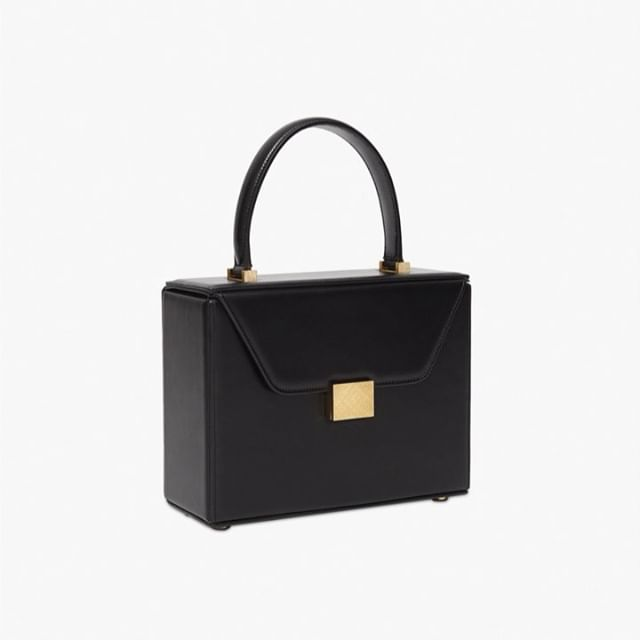 The perfect little black evening bag. The Vanity Top Handle bag is inspired by a vanity case with a sleek mirror embossed with the VB logo. Love this accessory! Discover it at the link in bio x VB