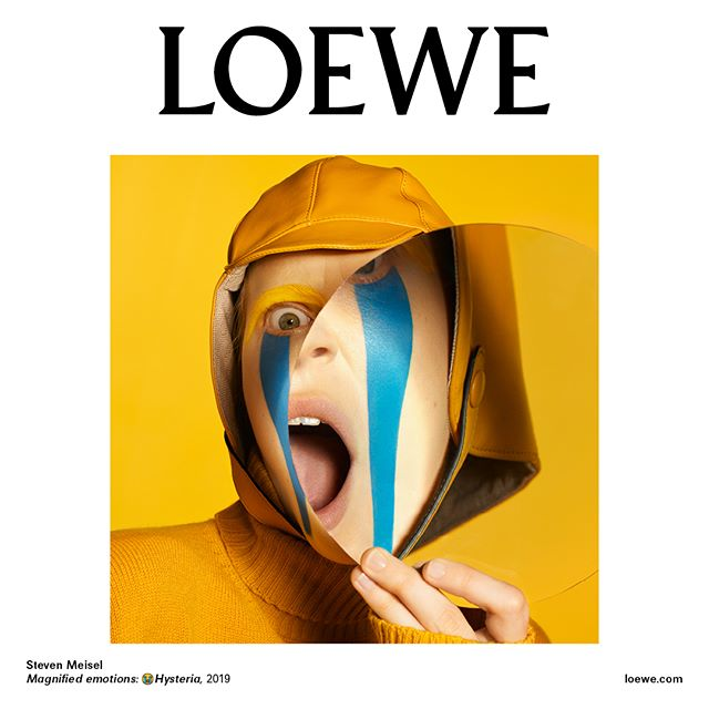 #LOEWEFW19 Campaign. Entitled  Magnified Emotions,  the series of colour portraits shot by #StevenMeisel is inspired by emoticons and shows model #JuliaNobis exaggerating her emotions with a giant magnifying lens.  Creative Direction @jonathan.anderson and @mmparisdotcom Styling @benjaminbruno_ Featuring @juliaobis Make up @patmcgrathreal Hair @guidopalau #LOEWE
