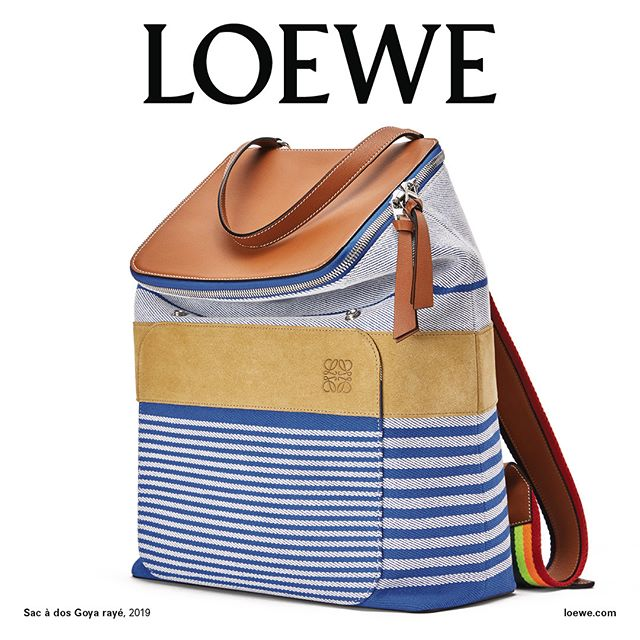 #LOEWEFW19 Campaign. The Goya backpack, named after our home in Madrid, is celebrated in a still-life. This nautical-inspired version is made from heavy duty cotton and playful rainbow webbing. Creative Direction @jonathan.anderson and @mmparisdotcom #LOEWE