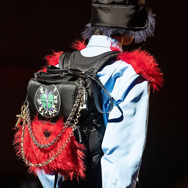 #PradaFW19 backpacks: a metaphor of one s own personal baggage.   Exaggerated charms are featured with chains and key holders together with coin purses at times decorated with symbols of the show.   Illustration by @JeanneDetellante.  Discover the #PradaFW19 Men s and Women s show via link in bio.   #Prada  #MiucciaPrada
